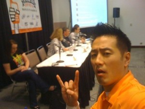 Larry Chiang takes a selfie while installing a female audience member to the VC panel